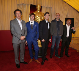 Nominated foreign film directors pose for a group photo during the 86th Academy Awards foreign film nominee preview at the Dolby Theatre in Hollywood