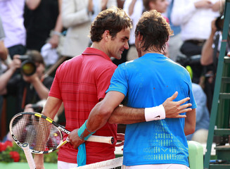 Nadal of Spain shakes hands with Federer of Switzerland after winning  their men's final at the French Open tennis tournament at the Roland Garros stadium in Paris