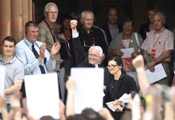 John Kelly, brother of Bloody Sunday shooting victim Michael Kelly, reacts as he leaves the Guildhall after reading the Saville report in Londonderry