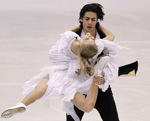 Weaver and Poje of Canada perform during the Ice Dance Free Dance competition at the ISU Four Continents Figure Skating Championships in Jeonju