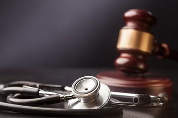 Judge gavel and stetoscope.