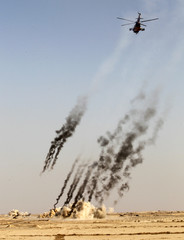 An Iraqi helicopter fires rockets during training at Basmaya military base in Baghdad