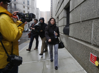 """Mother of New York City police officer Valle dubbed by local media as the """"cannibal cop"""" exits the Manhattan Federal Court following his conviction in New York"""