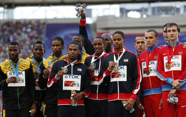 Medallists pose at the men's 4x400 metres relay victory ceremony during the IAAF World Athletics Championships at the Luzhniki stadium in Moscow
