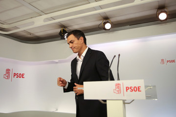 Spain's Socialist party (PSOE) leader Sanchez leaves after addressing the media at his party's headquarters in Madrid