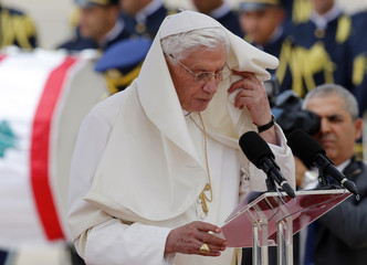 Pope Benedict XVI speaks on the podium upon his arrival at Beirut's airport