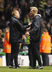 Celtic's manager Lennon and assistant manager Mjallby react to their side's performance against Rangers during their Scottish Premier League soccer match at Celtic Park