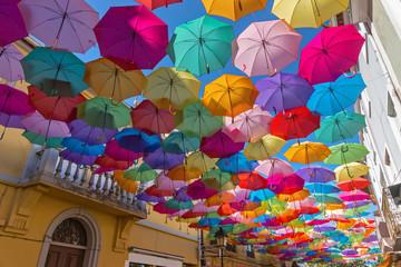 The sky of colorful umbrellas.Street with umbrellas.Umbrella Sky Project in Agueda, Aveiro district, Portugal.Background colorful umbrella street decoration