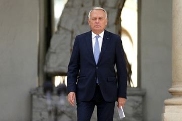 France's Prime Minister Ayrault arrives to speak to journalists at the Elysee Palace in Paris after a government seminar
