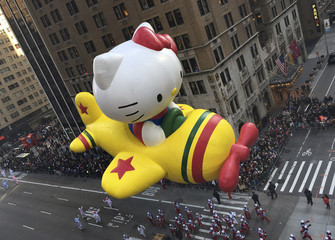 "The ""Hello Kitty"" balloon proceeds high above spectators along 6th Ave during the 89th Macy's Thanksgiving Day Parade in the Manhattan borough of New York"