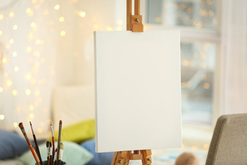 Clean canvas on easel in workroom