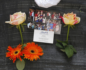 A business card bearing the name of Sydney siege victim, Lindt Cafe store manager Tori Johnson, is pictured at an impromptu memorial in Martin Place