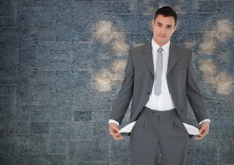 empty pockets businessman with rock wall background