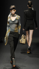 Models present creations by French-born designer Gaspard Yurkievich as part of his Fall/Winter 2010/11 women's ready-to-wear fashion show in Paris