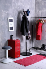 Modern hallway interior with hanging clothes