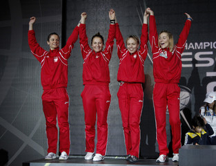 The Polish team jump on the podium after they won the silver in the finals of the team foil competition at the 2010 World Fencing Championships at the Grand Palais in Paris