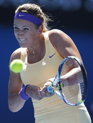 Victoria Azarenka of Belarus hits a return to Sloane Stephens of the U.S. during their women's singles semi-final match at the Australian Open tennis tournament in Melbourne