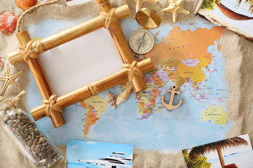 Travel concept. Composition with photo frame on world map background