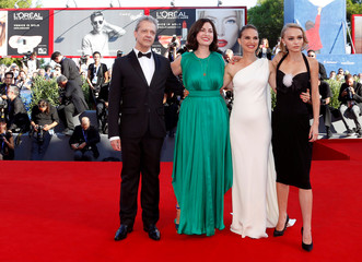 """Director Rebecca Zlotowski poses with actors Emmanuel Salinger, Natalie Portman, and Lily-Rose Depp as they attend the red carpet for the movie """"Planetarium"""" at the 73rd Venice Film Festival in Venice"""