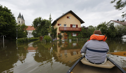 A resident boats through the flooded eastern Bavarian village of Niederalteich