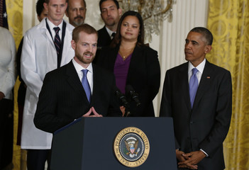 Ebola suvivor Dr. Brantly speaks next to U.S. Obama in the East Room of the White House in Washington