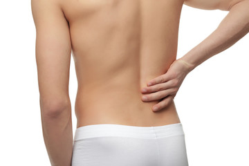 Young man suffering from back pain on white background, closeup