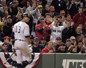 Fans cheer as New York Yankees Rodriguez heads back to the dugout after striking out against Boston Red Sox during their MLB baseball game in Boston