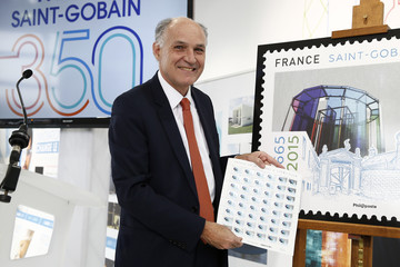 "Saint-Gobain Chairman and CEO Pierre-Andre de Chalendar, presents a commemorative postage stamp during a visit at the ""Future Sensations"" exhibition at the Place de la Concorde"