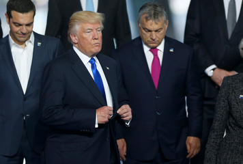 U.S President Donald Trump takes his place as NATO member leaders gather before the start of their summit in Brussels