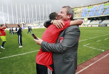 USM Alger's coach Rolland Corbis celebrates after winning their Algeria Cup final soccer match against MC Alger in Algiers