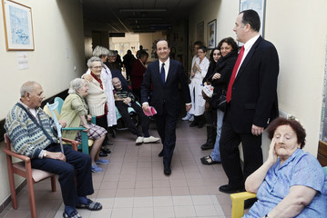 Francois Hollande, the Socialist Party candidate in the 2012 French presidential election, visits a medical care centre in Romans-sur-Isere