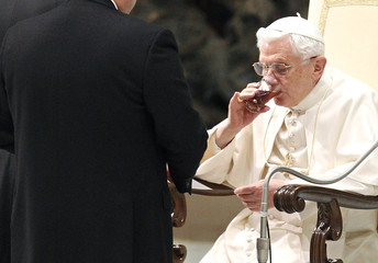 Pope Benedict XVI drinks as he leads the weekly general audience in Paul VI Hall at the Vatican