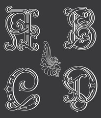 Set of uppercase white on black decorative font family typeface