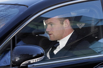 Manchester United striker Rooney leaves the Manchester Civil Justice Centre, in Manchester, northern England
