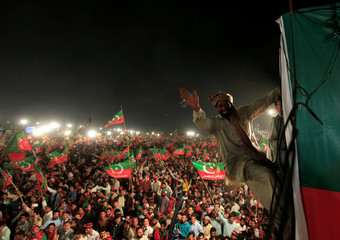 Supporters of opposition politician Imran Khan cheer at a celebration rally in Islamabad