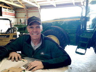Farmer Dave Kestel poses for a picture in his shed on his farm in Manhattan