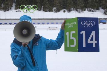 Saenger, VANOC biathlon manager, uses a bullhorn to describe some of the equipment that will be used for visitors at the venue in Whistler