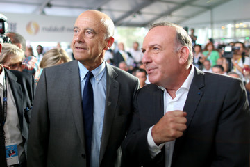 French presidential hopeful Alain Juppe stands next to French employer's body MEDEF union leader Pierre Gattaz at the MEDEF union summer forum on the campus of the HEC School of Management in Jouy-en-Josas