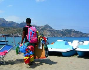 Italy, Sicily: Salesman in beach.