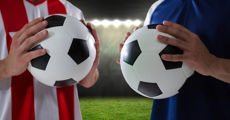 soccer players with ball in the field