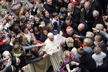Pope Francis is greeted during a visit to the Polish community at St. Stanislaw church in Rome