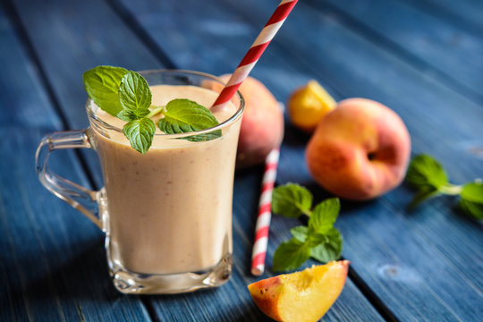 Healthy peach milkshake in a glass jar