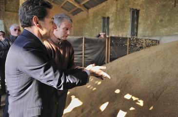France's President Nicolas Sarkozy visits a farm in Buno-Bonnevaux
