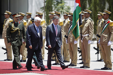 Palestinian President Abbas and his Colombian counterpart Juan Manuel Santos walk past an honour guard in Ramallah
