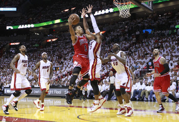 Bulls' Rose goes to the net on Heat's Wade during Game 4 of their Eastern Conference Finals NBA basketball series in Miami