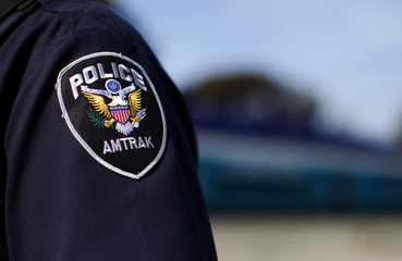 An Amtrak police officer's crest is seen during training for an active shooter scenario on a North County Transit train in Oceanside
