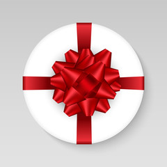 Vector white round gift box with shiny red scarlet bow and ribbon. Top View Close up