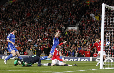 Manchester United's Hernandez shoots to score during their Champions League quarter-final second leg soccer match against Chelsea
