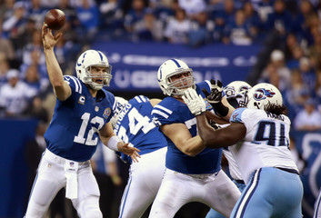Indianapolis' Andrew Luck throws with protection against Tennessee's during an NFL football game in Indianapolis, Indiana.