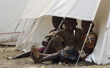 Congolese refugee children play outside their tent at Bukanga transit camp in Bundibugyo town